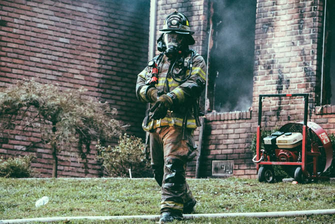 Firefighter in front of house
